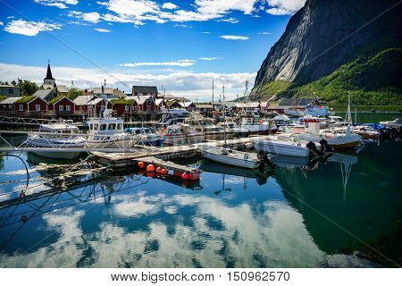 Marina boat Lofoten islands in the county of Nordland, Norway. Is known for a distinctive scenery with dramatic mountains and peaks, open sea and sheltered bays, beaches and untouched lands.