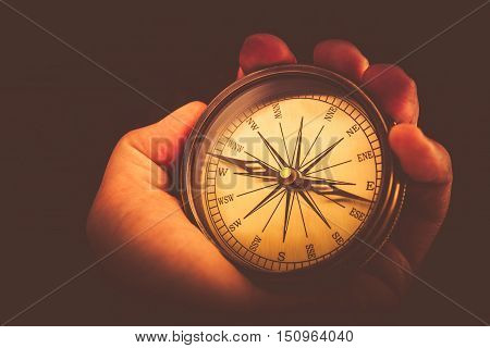 Reading Vintage Compass. Compass Device in Hand Closeup Photo. Orientation Equipment.