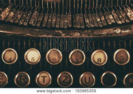 Vintage Typewriter Types Closeup Photo. Vintage Writing Equipment. Dark Sepia Color Grading
