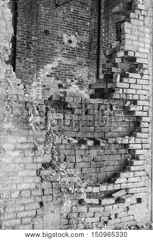 Crumbling Brick Wall of the former Power Plant at the Central Indiana Hospital for the Insane built in 1886 and abandoned in the 1970s V