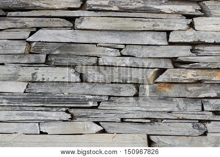 Layer of stone plate arranged as a wall / Stone wall background