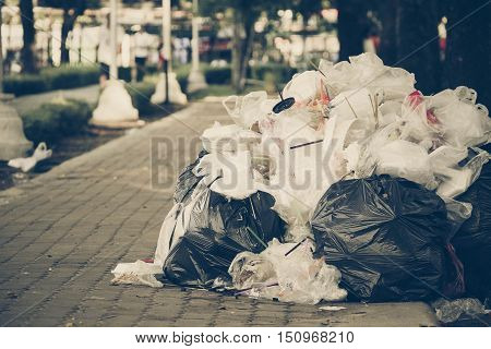 A pile of garbage in old sad tone / Waste and garbage mismanagement concept