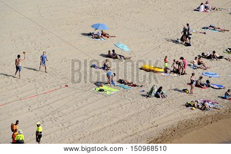 Tossa De Mar, Spain - August 2, 2014: View of the town beach in Tossa de Mar, Catalonia.