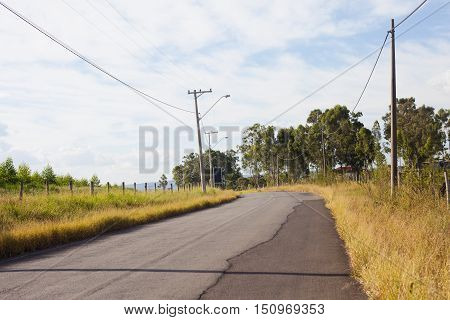 Country side street with power lines and trees