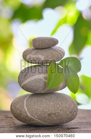 Balanced pebbles isolated on wooden table