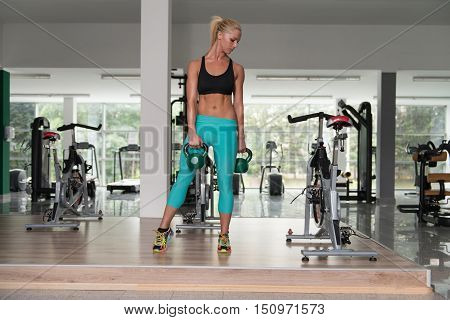 Healthy Young Woman Doing Exercise With Kettle Bellhealthy Young Woman Doing Exercise With Kettle Be