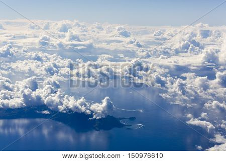 The aerial view of Fiji islands covered by clouds.