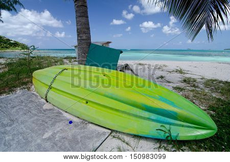 Green Plastic Canoe Drying At Cocobay Beach