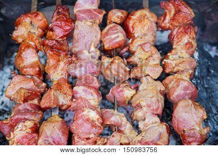 Cooking Pork Shashlik On Skewer, In Brazier Outdoors