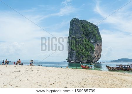 KRABI THAILAND - JUNE 1 2016: Unidentified tourists walk around and swim in the sea at Koh Poda in Krabi Thailand.