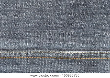 fabric pattern seam texture of denim or blue jeans for the design abstract background.