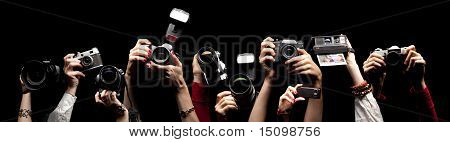 Raised Hands Holding Photocameras