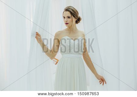 Yong Beautiful Bride Near The White Blinds