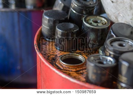 Picture of automobile oil filters from motor or engine background. Many filters for cars or automobiles isolated.