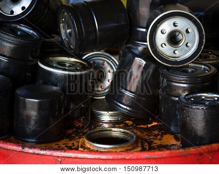 Closeup picture of old oil filters for automobile. Picture of motor oil as product of oil refining industry.
