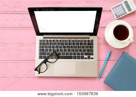 Equipment on desk in a office and copy space for input ideas and business concepts on pink wooden background.