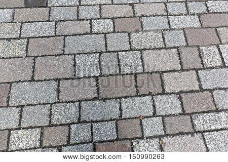 Granite Cobblestone Pavement Texture Background at Street