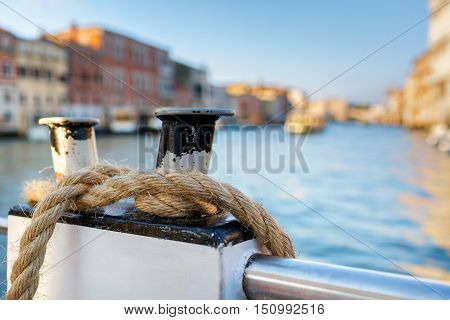 The rope is wound on a mooring.Boat on Canal Grande with Venezia. Shallow DOF