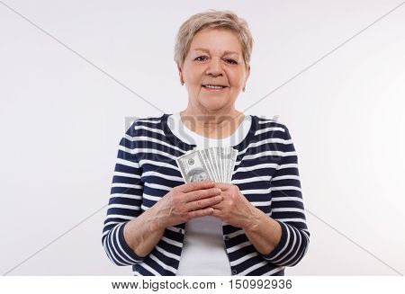 Happy Senior Female Holding Currencies Dollar, Concept Of Financial Security In Old Age