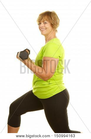 Middle Age Woman Exercising with Weights on a White Background. She is doing bicep curls and lunges at the same time.