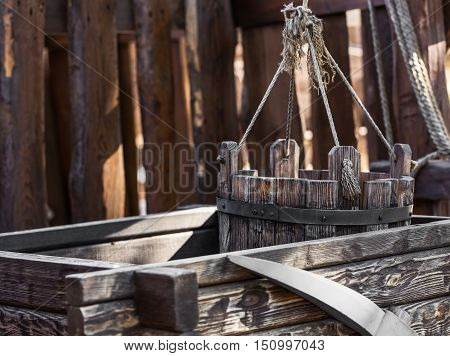 old wooden water well with a bucket closeup