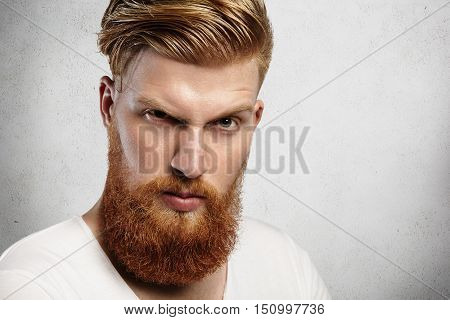Portrait Of Confident Macho Redhead Male Model With Severe And Rough Face Expression, Frowning, Look