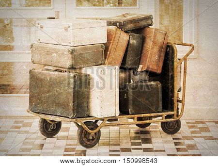 Trolley full of old luggage vintage setting
