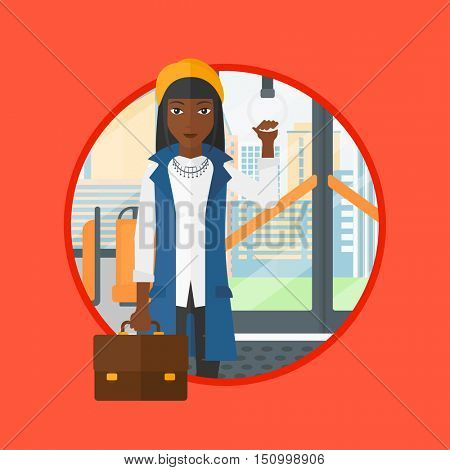 An african woman traveling by public transport. Woman standing in a public transport. Woman traveling by passenger bus or subway. Vector flat design illustration in the circle isolated on background.
