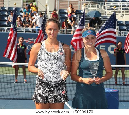 NEW YORK - SEPTEMBER 11, 2016: Viktoria Kuzmova (L) of Slovakia and  US Open 2016 girls junior champion Kayla Day of USA during trophy presentation at the Billie Jean King National Tennis Center