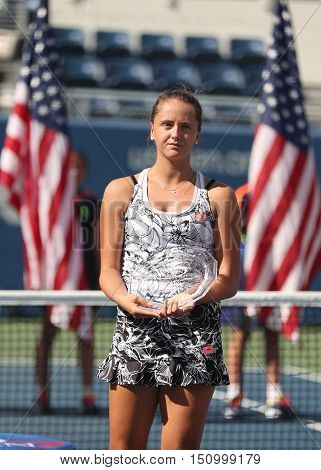 NEW YORK - SEPTEMBER 11, 2016:  US Open 2016 girls junior  runner up Viktoria Kuzmova of Slovakia during trophy presentation at the Billie Jean King National Tennis Center