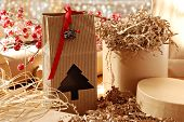 Christmas still life with eco friendly brown wrapping paper and gift packaging.  Close-up with shall