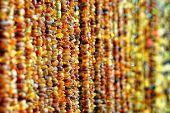 stock photo of gold glitter  - ropes of amber - JPG