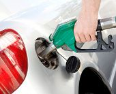 image of petrol  - A man pumping gas in to the tank - JPG