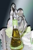 stock photo of ecclesiastical clothing  - Composition with bottle of oil and with cloths for Christening Day nickname