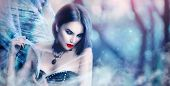 Fantasy Halloween Vampire woman portrait. Beauty Sexy Vampire Witch lady posing in deep forest, wear poster