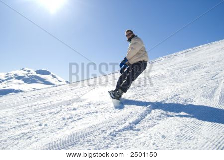 Snowboarding In The Sun Stock Photo
