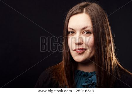 Portrait of an ironic woman on black background. Close-up.