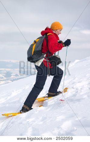 Backpacker Girl In Snow Shoes