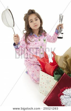 Disapointed Girl Child With Bad Christmas Gift