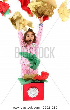 Excited Girl Child Throwing Wrapping Paper