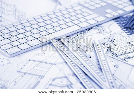 computer keyboard, samples of materials and architectural plans