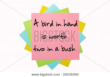 "Proverb ""a Bird In Hand Is Worth Two In A Bush"" Written On Bunch Of Sticky Notes"