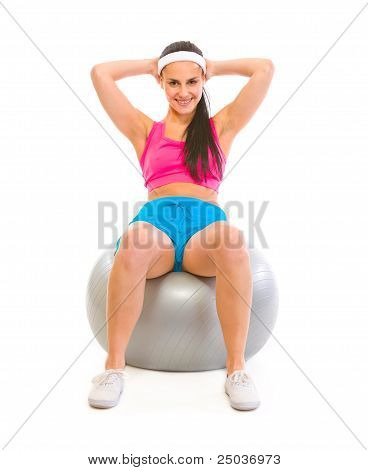 Smiling Fit Girl Making Abdominal Crunch On Fitness Ball