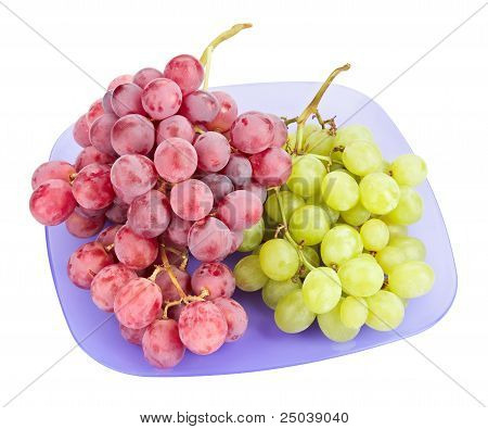 Red And White Grapes Bunches On Blue Plate Isolated On White