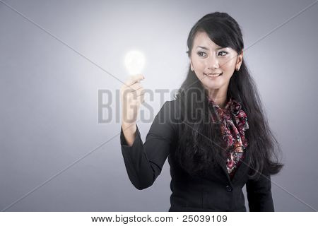 Asian Business Woman With Light Bulb