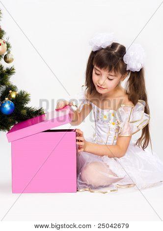Little Girl Opening Christmas Present