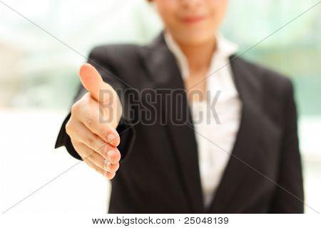 Business woman giving handshake