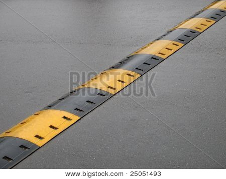 speed bump on wet road