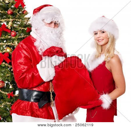 Santa claus and  girl giving present by christmas tree. Isolated.