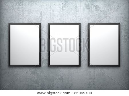 Three blank frames on concrete wall.